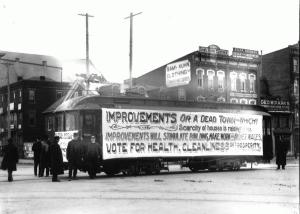 The photograph below shows a trolley with an advertisement for improvement in the year 1903.