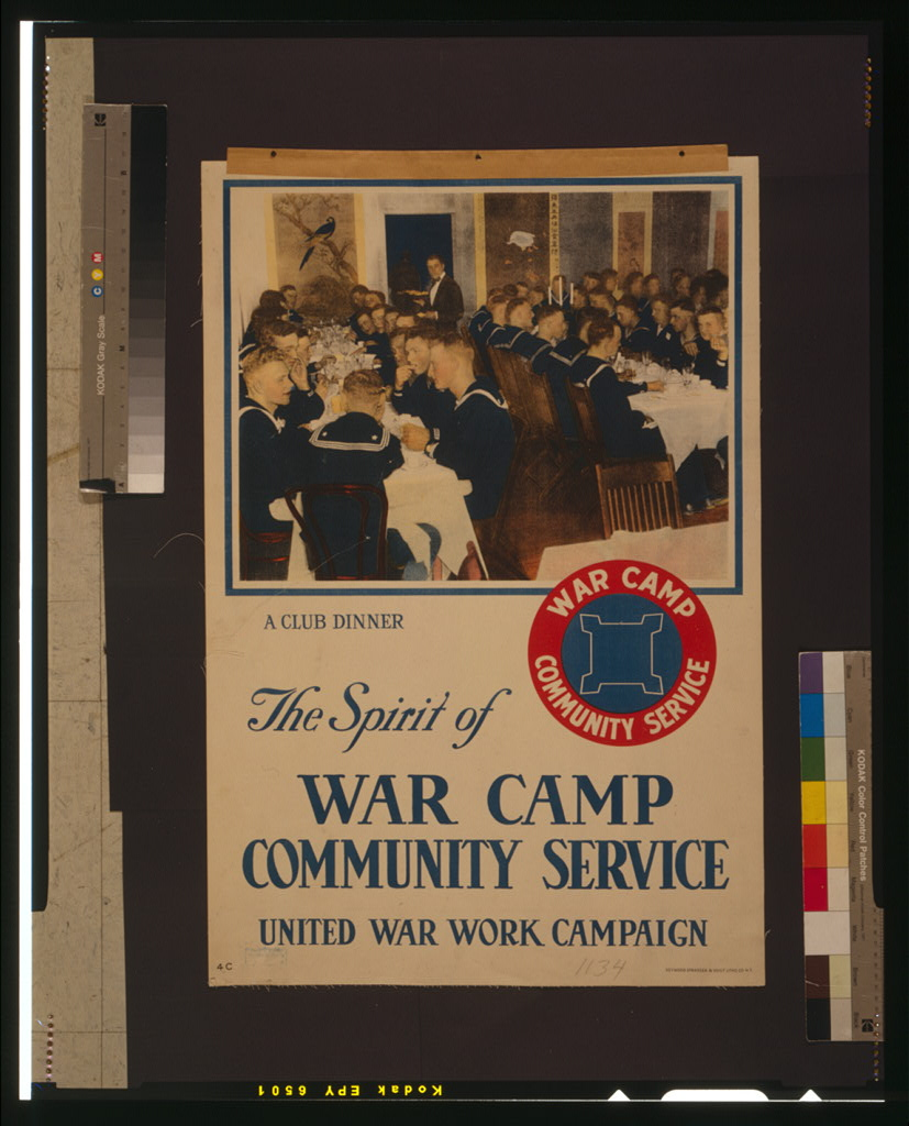 """A photograph of a vintage poster. It has an image of rows of white men in navy uniforms eating in a dining hall, with the caption """"a club dinner."""" It has a small blue and red logo with the words """"war camp community service"""" around the outside. In big font, the bottom half of the poster reads """"The Spirit of War Camp Community Service United War Work Campaign""""."""